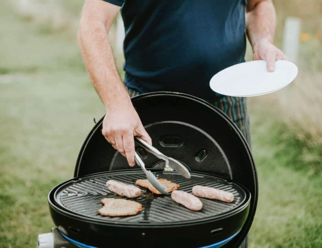 a person cooking healthy grilling steaks